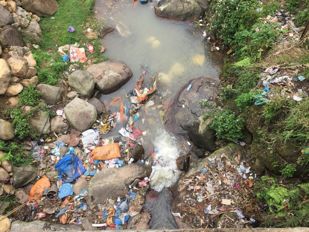 Huge amounts of plastic just thrown into the river. Sapa.